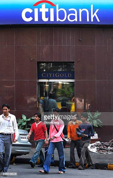 People walk past a branch of Citibank in Mumbai India on Thursday Nov 29 2007 India's economy grew last quarter at the slowest pace since 2006...