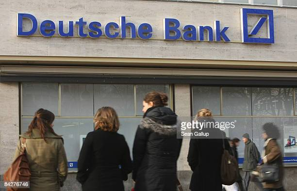 People walk past a branch of Deutsche Bank Germany's biggest commercial bank on January 14 2009 in Berlin Germany Deutsche Bank announced today that...