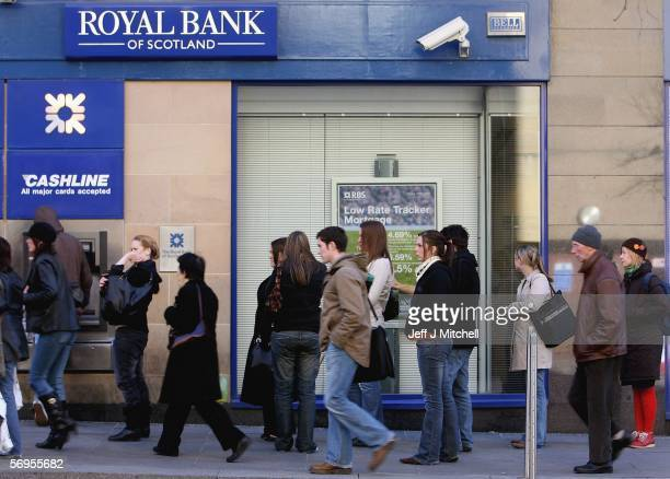 People walk past a branch of Royal Bank of Scotland February 28 in Glasgow Scotland The bank has today unveiled a record GBP8 billion pound pretax...