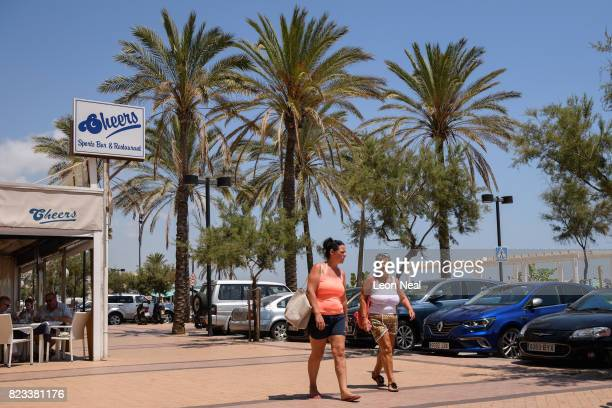 People walk past a British Cheers sports bar on July 25 2017 in Fuengirola Spain With Brexit discussions yet to provide answers to a number of...