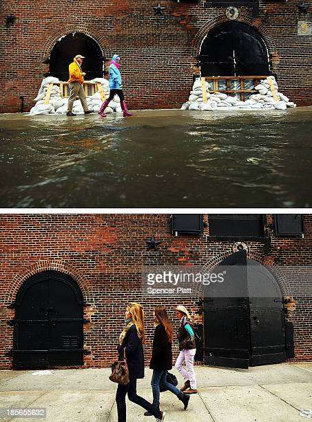People walk past sandbags on a flooded street as Hurricane Sandy moves closer to the area on October 29 2012 in the Red Hook section of the Brooklyn...