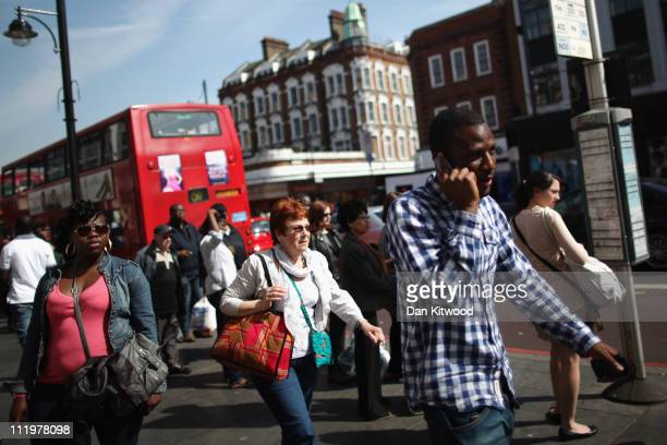 People walk past a bus stop in Brixton on April 11 2011 in London England Today marks the 30th anniversary of the Brixton riots The 1981 Brixton...