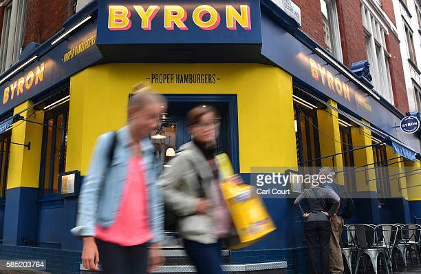 People walk past a Byron burger restaurant on August 2 2016 in London England The British restaurant chain are alleged to have organised a training...
