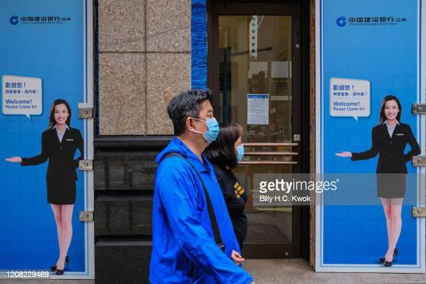 People walk past a China Construction Bank during a coronavirus outbreak on March 26 2020 in Hong Kong China Latest statistics showed Hong Kong...