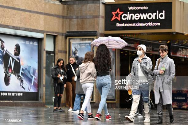 People walk past a cineworld cinema in Leicester Square in central London on October 4 2020 Cineworld is set to close its 128 UK sites in the coming...