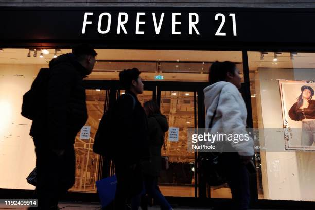 People walk past a closed-down branch of former fast-fashion retailer Forever 21 on Oxford Street in London, England, on January 7, 2020. Forever 21...