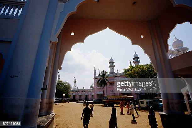 People walk past a decorative arch in Trivandrum also called Thiruvananthapuram the capital city of Kerala India | Location Trivandrum India
