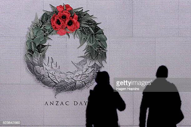 People walk past a degital sign during Dawn Service at Pukeahu National War Memorial Park on April 25 2016 in Wellington New Zealand In 1916 the...