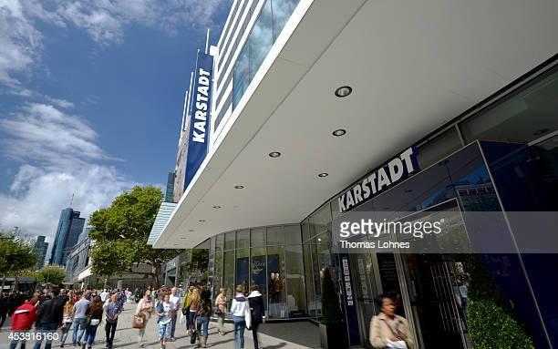 People walk past a department store of German retailer Karstadt on August 19 2014 in Frankfurt Germany Austrian investor Rene Benko has taken over...