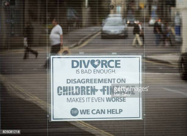 People walk past a divorce lawyer's poster in a office window in Redruth on July 24 2017 in Cornwall England Figures released by Eurostat in 2014...