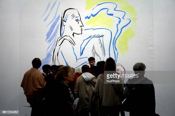 People walk past a drawing of Camille Henrot in Palais De Tokyo in Paris France on November 24 2017