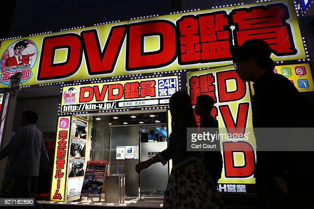 People walk past a DVD shop on April 30 2016 in the Shinjuku area of Tokyo Japan The Greater Tokyo Area is the most populous metropolitan area in the...