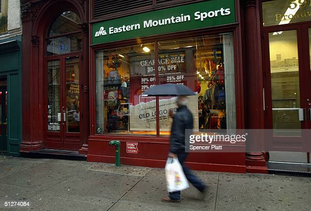 People walk past a Eastern Mountain Sports store September 8 2004 in New York City Managers and a group of investors have purchased Eastern Mountain...