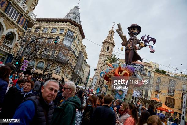 People walk past a Falla during Las Fallas Festival on March 17 2018 in Valencia Spain The Fallas is Valencias most international festival which runs...