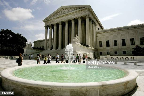 People walk past a fountain in front of the U.S. Supreme Court June 13, 2005 in Washington DC. The court refused to hear the case of terror suspect...