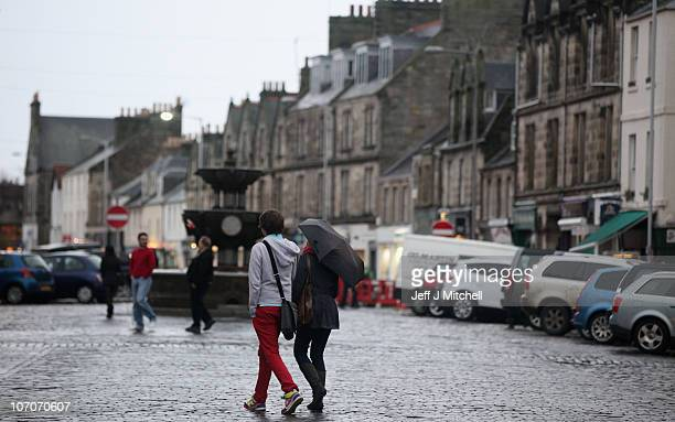People walk past a fountain on November 22, 2010 in St Andrews, Scotland. The newly engaged Prince William and Kate Middleton studied at the...
