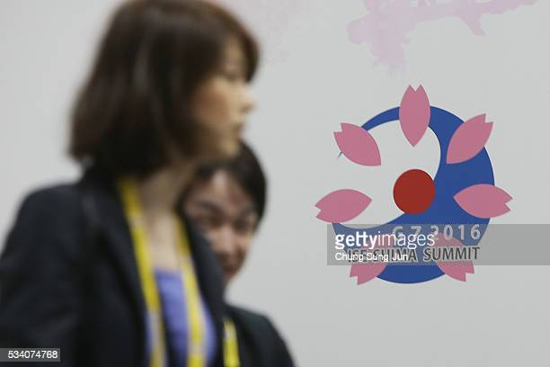 People walk past a G7 Summit sign at the IMC on May 24 2016 in Shima Japan The G7 summit will be held in Kashikojima Island of Japan on May 26 and 27...