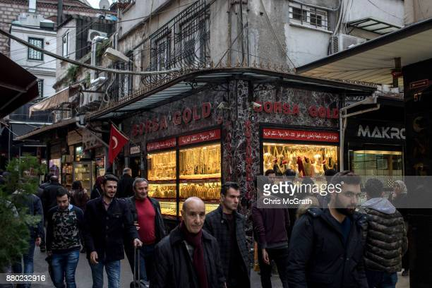 People walk past a gold store on November 27 2017 in Istanbul Turkey The trial of Mr Reza Zarrab an IranianTurk who ran a foreign exchange and gold...