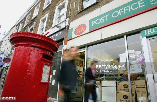 People walk past a high street Post Office on November 1 2004 in London England The Royal Mail has dampened down reports that it is too close or sell...