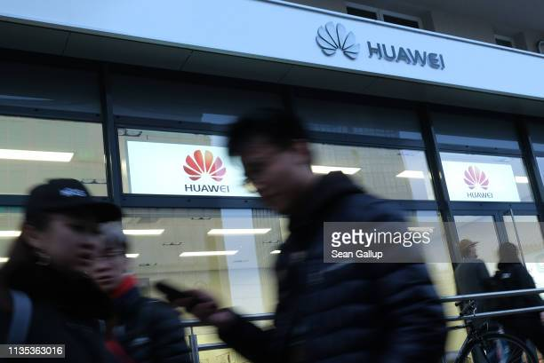 People walk past a Huawei customer service center on March 12 2019 in Berlin Germany The US government has warned Germany not to consider Huawei for...