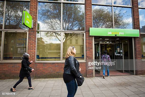 People walk past a Job Centre in Westminster on May 3 2016 in London England The Resolution Foundation chaired by former Conservative Minister David...