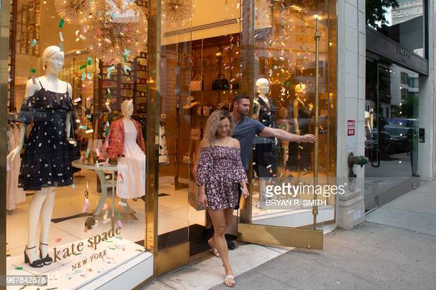 People walk past a Kate Spade boutique on June 5 2018 in New York Spade one of the biggest names in American fashion was found dead in New York after...