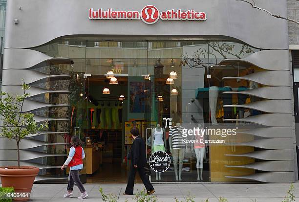 People walk past a Lululemon Athletica Inc. Store on March 19, 2013 in Glendale, California. Lululemon removed some of its popular pants from stores...