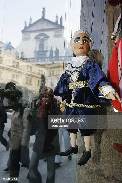 People walk past a marionette of Austrian composer Wolfgang Amadeus Mozart at a shop January 23 2006 in Prague Czech Republic Mozart stayed and...
