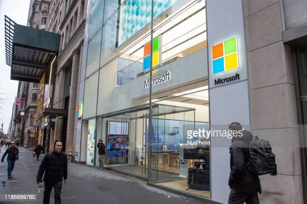 People walk past a Microsoft store entrance with the company's logo on top in midtown Manhattan at the 5th avenue in New York City US on 11 November...