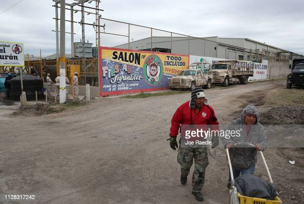 People walk past a migrant hostel where migrants are waiting to apply for asylum in to the United States on February 08 2019 in Piedras Negras Mexico...