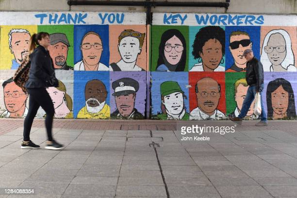 People walk past a mural thanking key workers during the covid-19 pandemic in the High Street on October 28, 2020 in Southend-on-Sea, England.