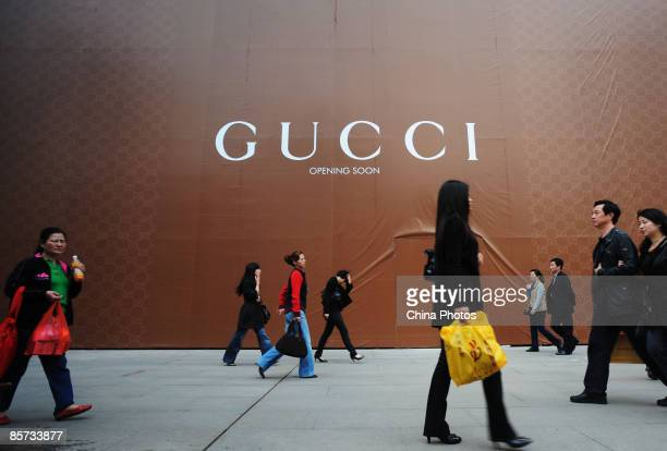 People walk past a new Gucci store to be opened soon at the Wuhan International Plaza on March 21 2009 in Wuhan of Hubei Province China Luxury brands...