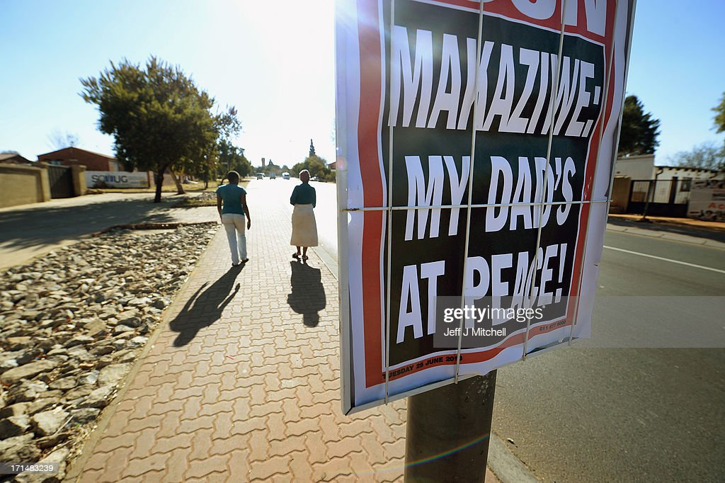 People walk past a newspaper billboard which hangs on a lamp post quoting Makaziwe Mandela, the oldest daughter of former South African President Nelson Mandela on June 25, 2013 in Soweto Township, Johannesburg, South Africa. South African President Jacob Zuma confirmed Sunday that Mandela's condition has become critical since he was admitted to the hospital over two weeks ago for a recurring lung infection.