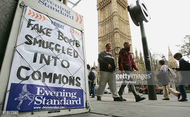 People walk past a newspaper stand across the road from Britain's Houses of Parliament on September 17 2004 in London England Britain's Commons...