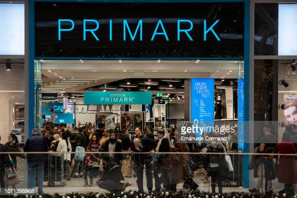 People walk past a Primark flagship store at Il Centro shopping mall during the Black Friday sales on November 23 2018 in Milan Italy Known as 'Black...