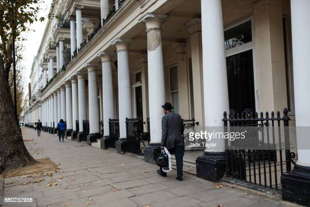 People walk past a row of houses in Kensington on November 24 2017 in London England The American actress Meghan Markle will live at Nottingham...