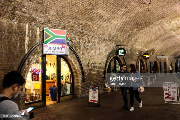People walk past a row of small businesses situated in arches under Waterloo Station on September 11 2018 in London England Network Rail has sold...