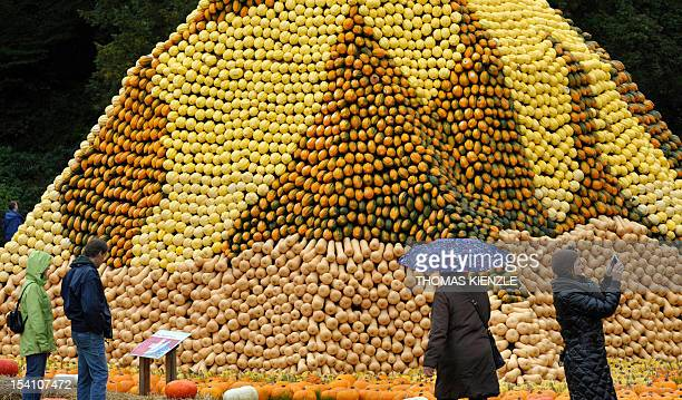 People walk past a sculpture of the Swiss Matterhorn made of pumpkins at a pumpkin exhibit at the Baroque Castle in Ludwigsburg southwestern Germany...