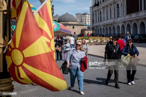 People walk past a shop selling Macedonian flags on September 28, 2018 in Skopje, Macedonia. Macedonians will go to the polls Sunday to vote in a...
