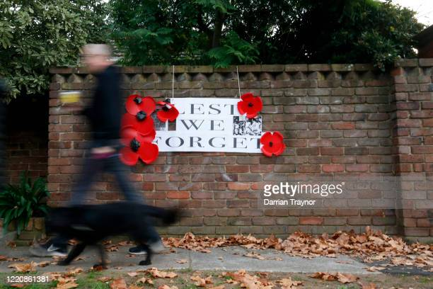 People walk past a sign supporting ANZAC Day in Kew on April 25 2020 in Melbourne Australia Traditional Anzac Day ceremonies have been cancelled due...