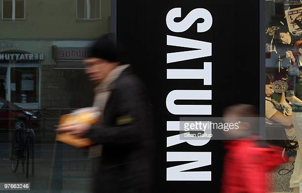 People walk past a store of German consumer electronics retail chain Saturn on March 12 2010 in Berlin Germany Saturn is owned by Metro Group which...