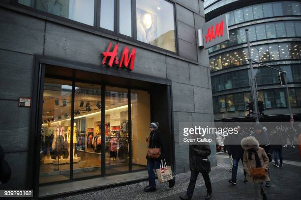 People walk past a store of Swedish clothing retailer H&M on March 28, 2018 in Berlin, Germany. H&M, which is the world's second largest clothing...