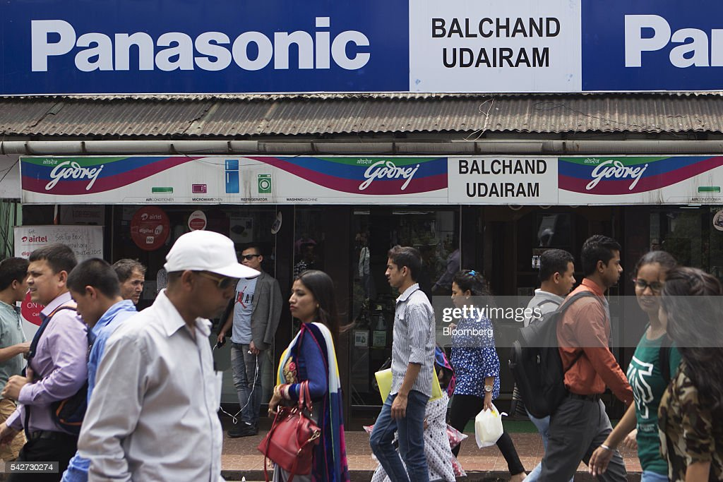 People walk past a store on Mahatma Gandhi Road in Gangtok, India, on Tuesday, May 3, 2016. Year-on-year growth in Asia's third-largest economy accelerated in the first three months of 2016 to 7.9 percent. Photographer: Prashanth Vishwanathan/Bloomberg via Getty Images