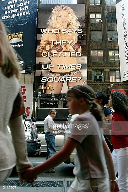 People walk past a threestory billboard featuring porn actress Jenna Jameson in Times Square August 20 2003 in New York City The ad touts Jamison's...