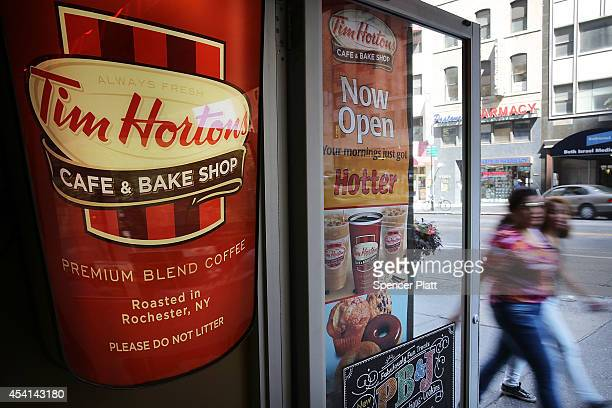 People walk past a Tim Horton's cafe in Manhattan on August 25 2014 in New York City It has been confirmed that American fast food giant Burger King...