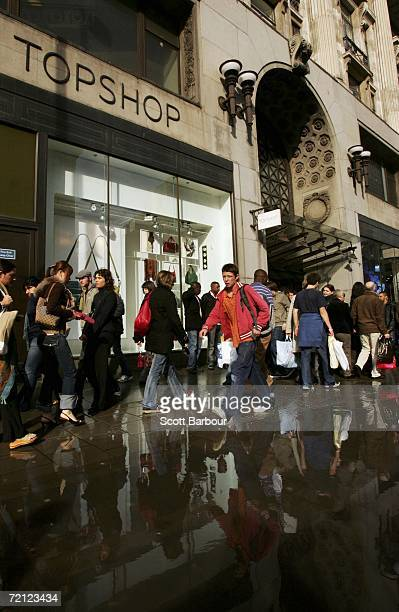 People walk past a Topshop and Topman store on Oxford Street on October 6 2006 in London England The boss of the High Street retailer Topshop Sir...
