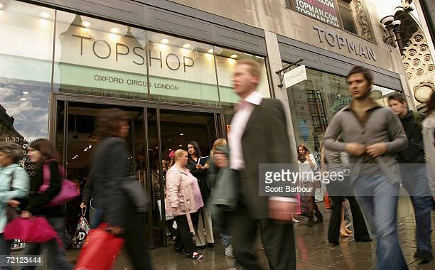 People walk past a Topshop and Topman store on Oxford Street on October 6, 2006 in London, England. The boss of the High Street retailer Topshop, Sir...