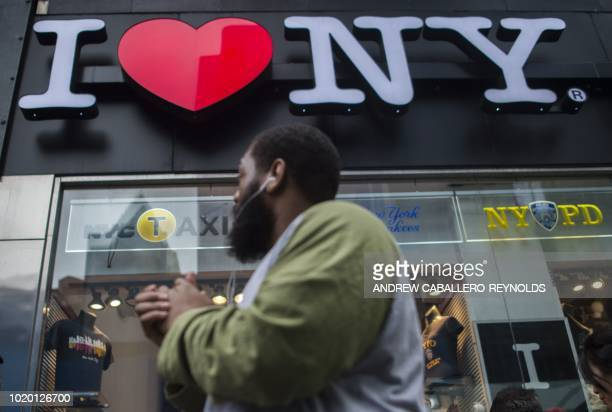 People walk past a tourist shop in New York New York on August 20 2018