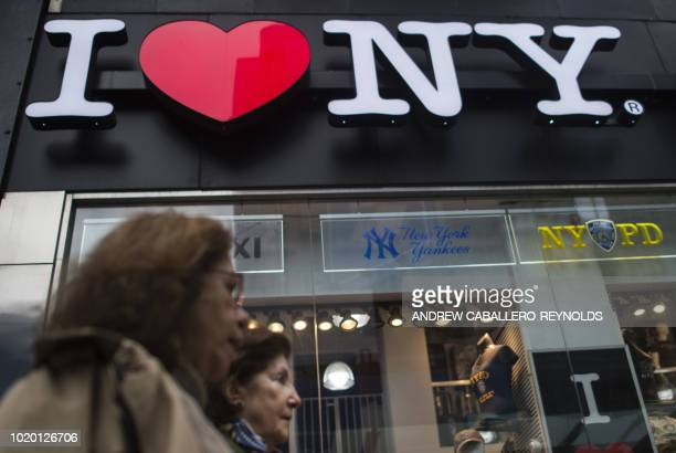 People walk past a tourist shop in New York on August 20 2018