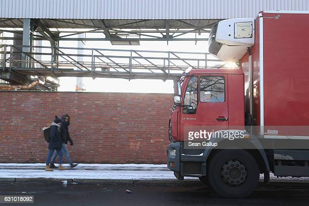 People walk past a truck parked in FriedrichKrauseUfer street on January 5 2017 in Berlin Germany According to police Anis Amri the Tunisian man...